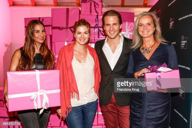 Sila Sahin Nina Bott Alexander Klaws and Sylvie Mutschler attend the Late Night Shopping Designer Outlet Soltau on August 28 2014 in Soltau Germany