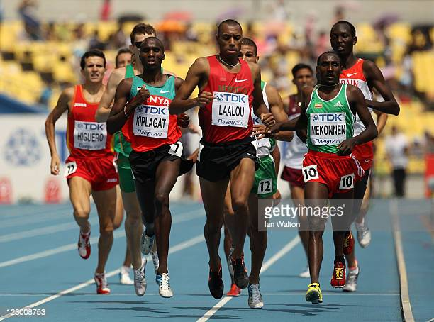 Silas Kiplagat of Kenya, Amine Laalou of Morocco and Deresse Mekonnen of Ethiopia compete in the men's 1500 metres heats during day four of the 13th...