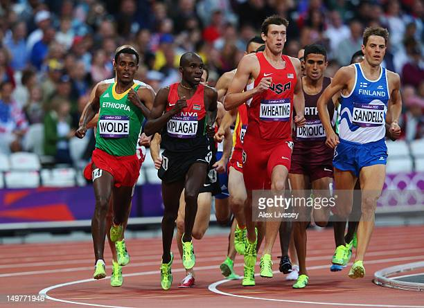 Silas Kiplagat of Kenya, Andrew Wheating of the United States and Niclas Sandells of Finland compete in the Men's 1500m Round 1 Heats on Day 7 of the...