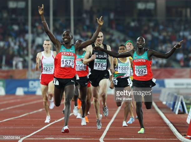 Silas Kiplagat of Kenya celebrates as he wins gold from silver medalist James Magut of Kenya and bronze medalist Nick Willis of New Zealand in the...