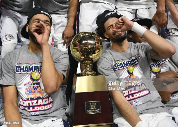 Silas Melson and Josh Perkins of the Gonzaga Bulldogs celebrate with the trophy after defeating the Brigham Young Cougars 7454 to win the...