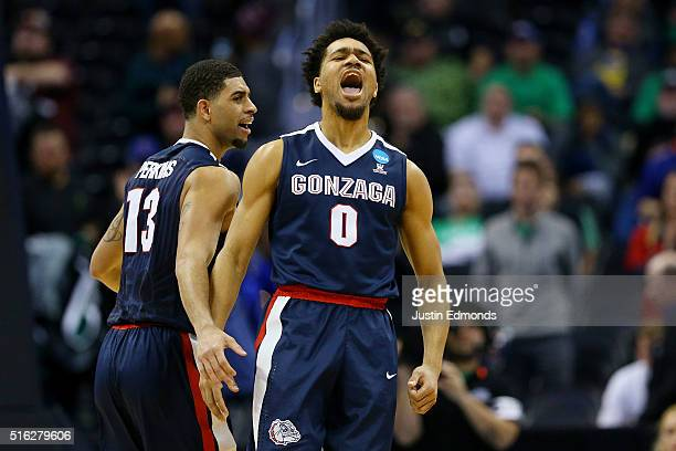 Silas Melson and Josh Perkins of the Gonzaga Bulldogs celebrate their 68 to 52 win over the Seton Hall Pirates during the first round of the 2016...