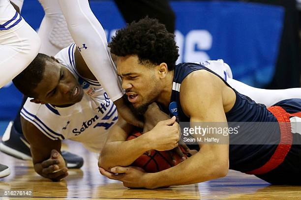 Silas Melson of the Gonzaga Bulldogs and Isaiah Whitehead of the Seton Hall Pirates vie for posession in the first half during the first round of the...