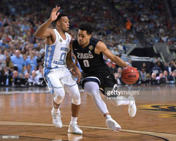 Silas Melson of the Gonzaga Bulldogs drives against Nate Britt of the North Carolina Tar Heels during the 2017 NCAA Men's Final Four Championship at...
