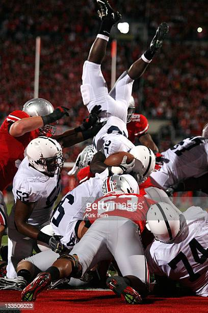 Silas Redd of the Penn State Nittany Lions is stopped short of the goal line by the defense of the Ohio State Buckeyes during the third quarter on...