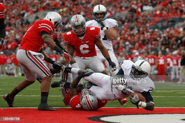 Silas Redd of the Penn State Nittany Lions runs over CJ Barnett of the Ohio State Buckeyes to score during the second quarter on November 19 2011 at...