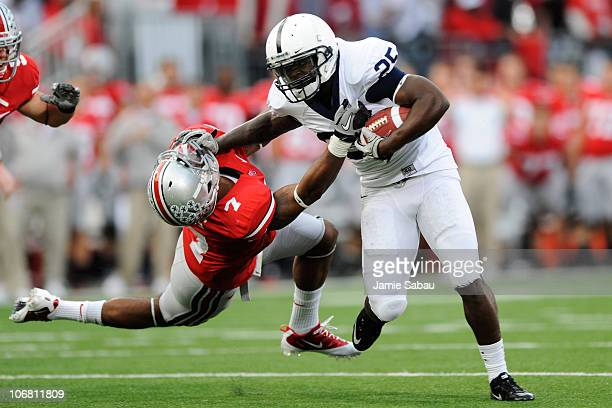 Silas Redd of the Penn State Nittany Lions stiff arms Jermale Hines of the Ohio State Buckeyes at Ohio Stadium on November 13 2010 in Columbus Ohio
