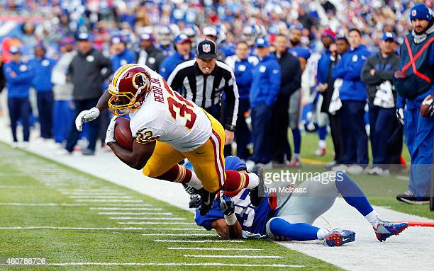 Silas Redd of the Washington Redskins in action against Quintin Demps of the New York Giants on December 14, 2014 at MetLife Stadium in East...