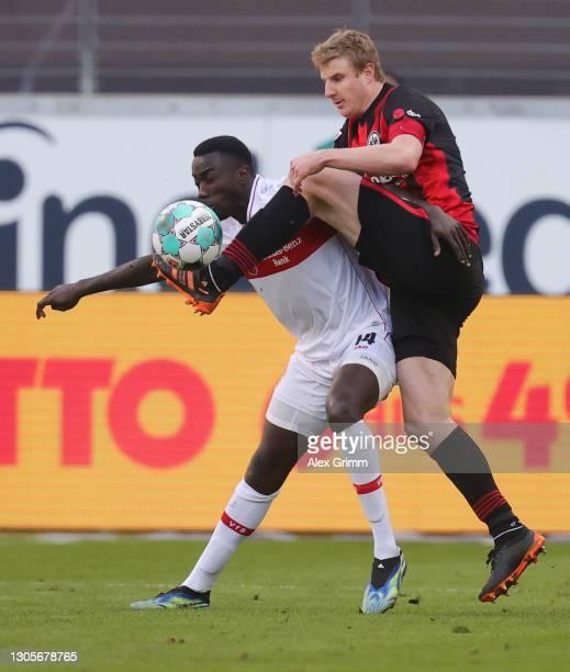 Silas Wamangituka of Stuttgart is challenged by Martin Hinteregger of Frankfurt during the Bundesliga match between Eintracht Frankfurt and VfB...