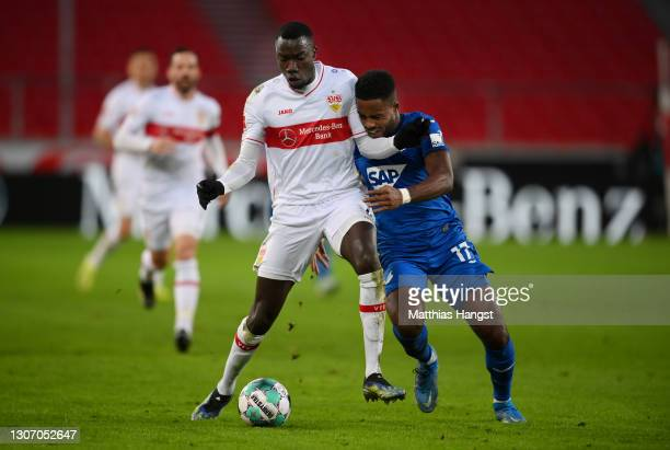 Silas Wamangituka of VfB Stuttgart battles for possession with Ryan Sessegnon of TSG 1899 Hoffenheim during the Bundesliga match between VfB...