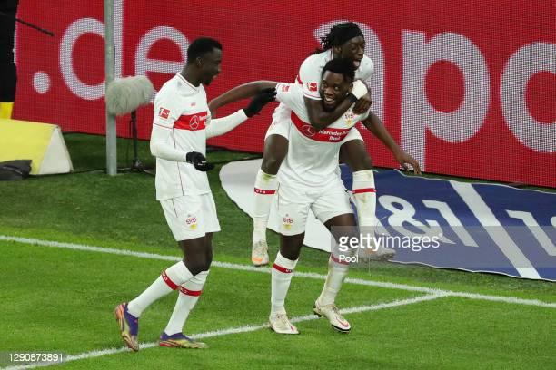 Silas Wamangituka of VfB Stuttgart celebrates with Orel Mangala after scoring their team's second goal during the Bundesliga match between Borussia...
