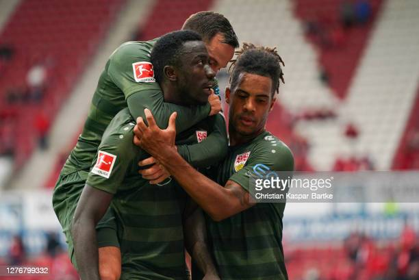 Silas Wamangituka of VfB Stuttgart celebrates with teammate Gonzalo Castro and Daniel Didavi after scoring his sides first goal during the Bundesliga...