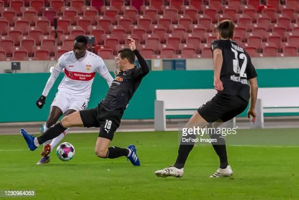 Silas Wamangituka of VfB Stuttgart, Stefan Lainer of Borussia Moenchengladbach and Florian Neuhaus of Borussia Moenchengladbach battle for the ball...