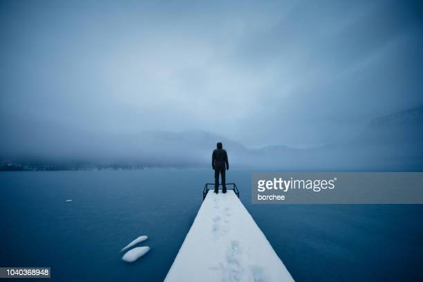 silence by the frozen lake - overcast stock pictures, royalty-free photos & images