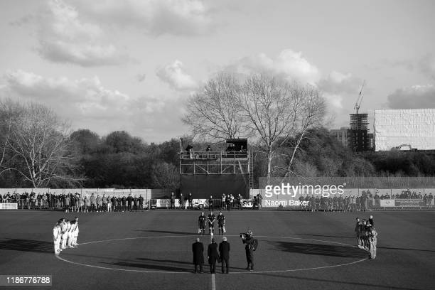 Silence is observed for Remembrance Day by officials, players and fans prior to the FA Cup First Round match between Hayes & Yeading and Oxford...
