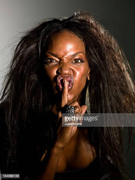 silence, you bastard! - ugly black women stock photos and pictures