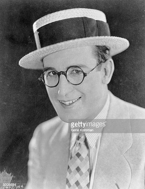 Silent comic Harold Lloyd wearing glasses and a straw boater