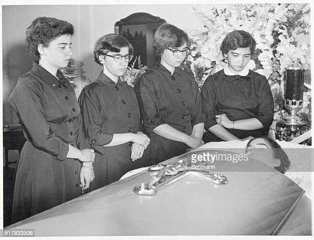 Silent Farewell to Emilie Callander Ontario The four surviving Dionne quintuplets Cecile Marie Yvonne and Annette stand with sorrowladen faces beside...