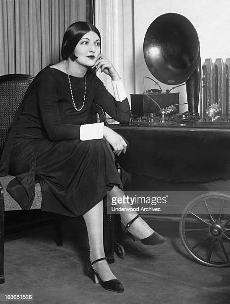 Silent film actress Dagmar Godowsky listens to her father composer Leopold Godowsky play a piano concert over the radio Hollywood California October...