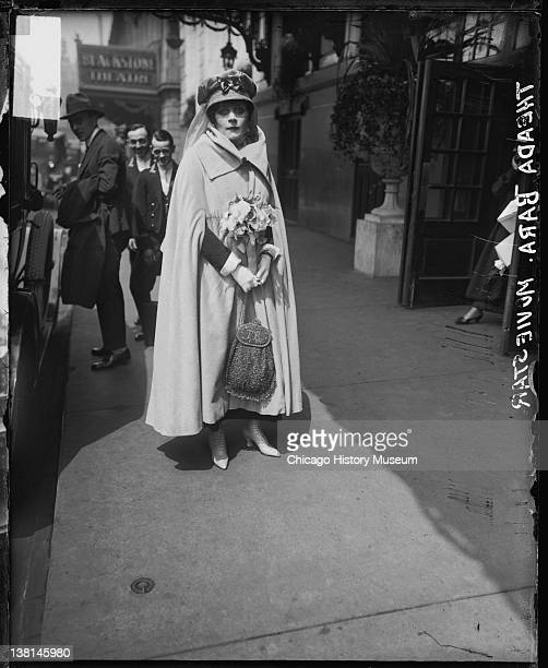 Silent film actress Theda Bara standing outside the Blackstone Theater Chicago Illinois 1917