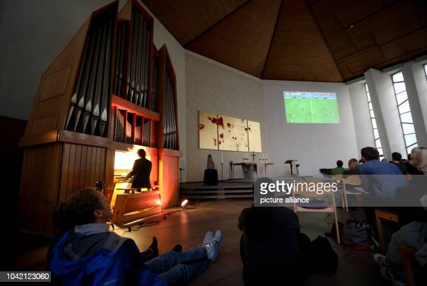 Silent movie pianist Stephan Graf von Bothmer accompanies the FIFA World Cup match Spain vs The Netherlands on a pipe organ in place of the reporter...