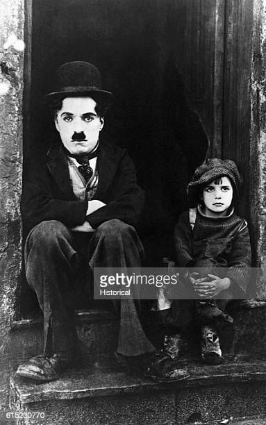 Silent movie star Charlie Chaplin with costar Jackie Coogan in a still frame of the movie The Kid The 1921 film made Coogan famous and established...