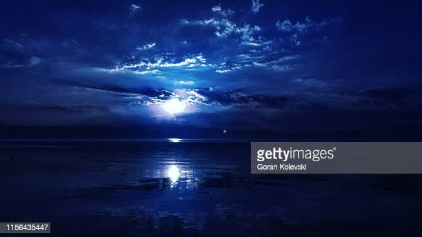 silent night - tropical island sunset stock pictures, royalty-free photos & images