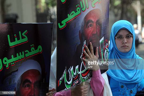 Silent protest is held by the Arab Doctors Union outside the British Embassy in Cairo on July 12 to demand an immediate release of sheikh Raed Salah,...