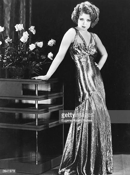 Silent screen siren Clara Bow popularly known as the 'It' girl wears a silver lame dress for the Paramount film 'No Limit' directed by Frank Tuttle