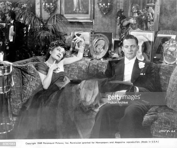 Silent screen star Gloria Swanson formerly Gloria Svensson stars with William Holden formerly William Beedle in the biting Hollywood satire 'Sunset...