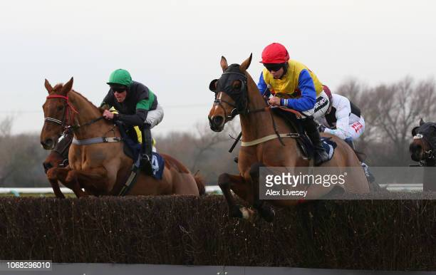 Silent Steps ridden by Bryony Frost clears a fence ahead of Archview Sunshine ridden by John Kington on their way to victory in the Bet At toalscom...