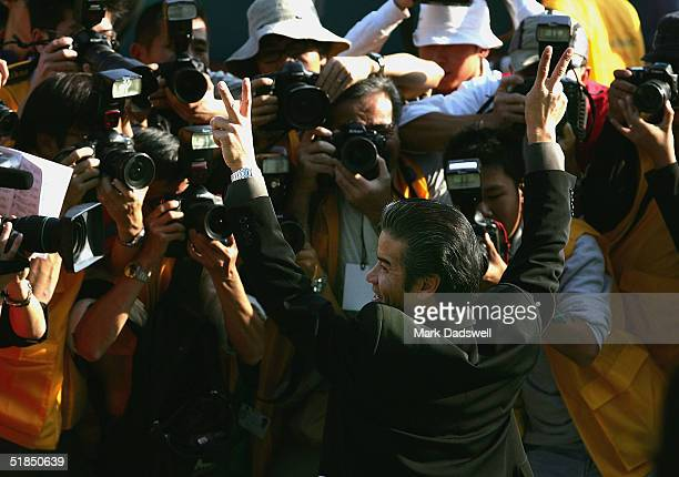 Silent Witness trainer Tony Cruz poses for photographers after winning the Cathay Pacific Hong Kong Sprint during the Cathay Pacific Hong Kong...