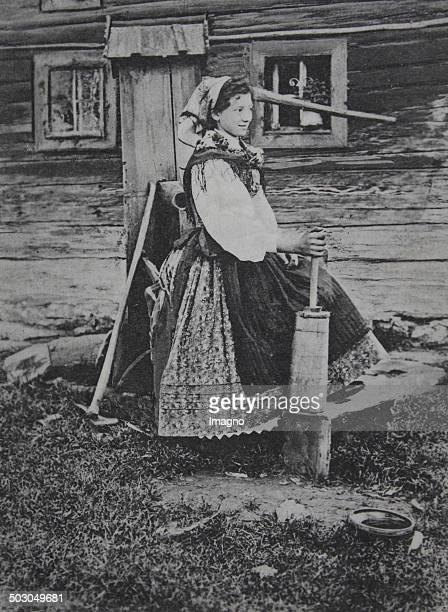 Silesian peasant girl in the butter stirring Austrian Silesia Poland 1914 Photograph