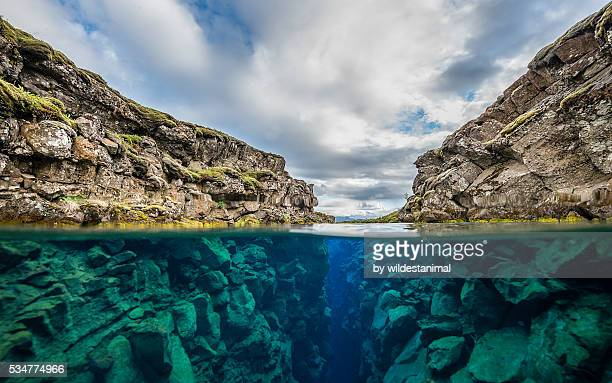 silfra crack above and below water - plate tectonics stock photos and pictures