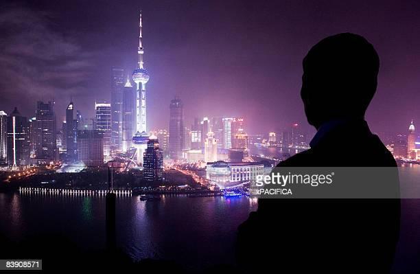 A silhouette against Shanghai's skyline.