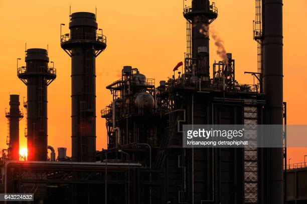 Silhouette and Petrochemical industrial plant power station at sunset and ,view,Amata City Industrial Thailand.