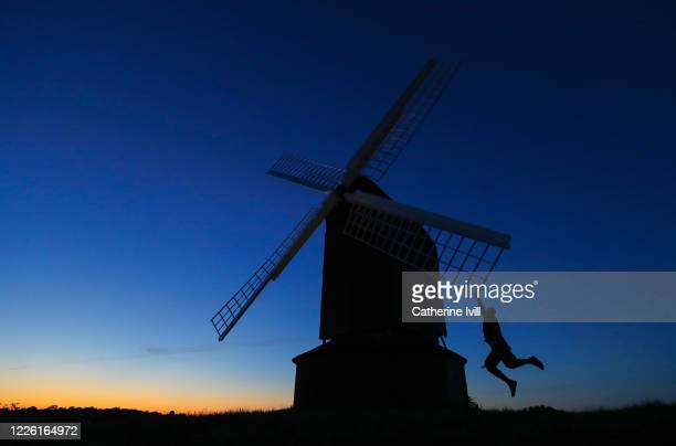 Silhouette as someone jumps in the air at Brill Windmill on May 19, 2020 in Brill, England. The British government has started easing the lockdown it...