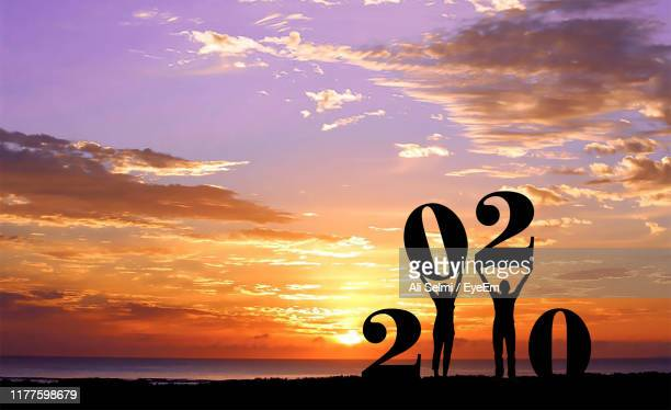silhouette beach against sky during sunset - 2020年 ストックフォトと画像