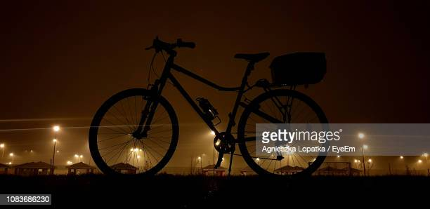Silhouette Bicycle Against Sky At Night