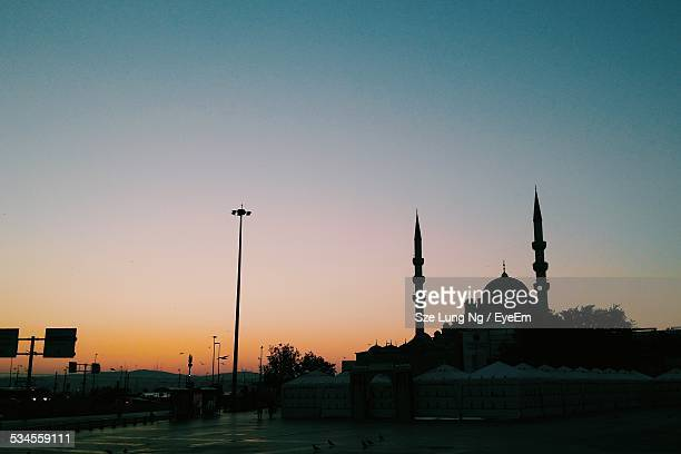 silhouette blue mosque against clear sky at dusk - ankara turkey stock pictures, royalty-free photos & images