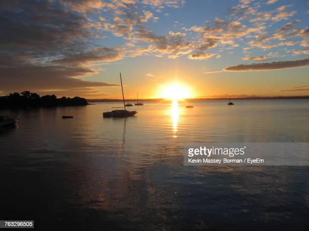 Silhouette Boats Moored On Sea Against Sky During Sunset