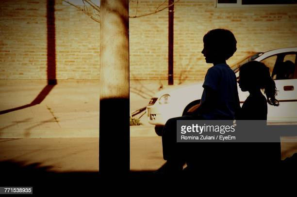 Silhouette Boy And Girl By Street