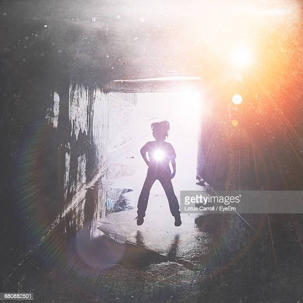 Silhouette Boy Jumping In Tunnel