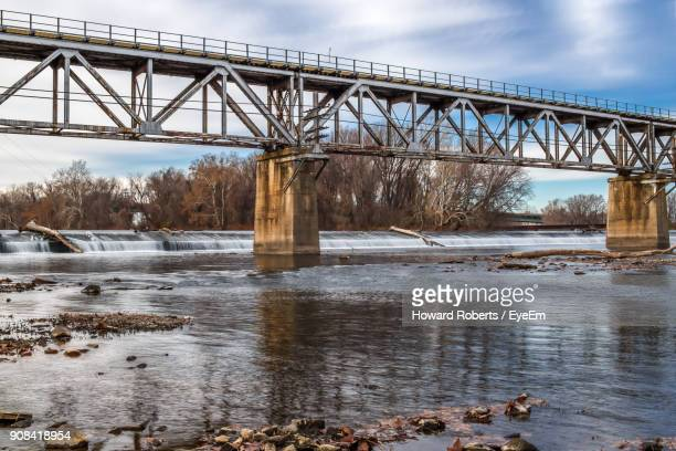 silhouette bridge over river against sky - norristown stock pictures, royalty-free photos & images