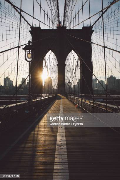 silhouette brooklyn bridge against sky during sunrise - bortes stock pictures, royalty-free photos & images