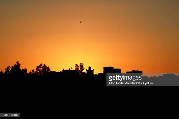 Silhouette Buildings Against Clear Orange Sky During Sunset
