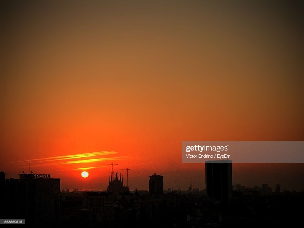 Silhouette Buildings Against Romantic Sky At Sunset : Stock Photo