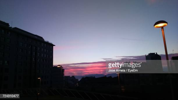 silhouette buildings against sky at dusk - vigo stock pictures, royalty-free photos & images