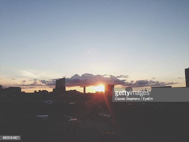 Silhouette Buildings Against Sky During Sunset In City
