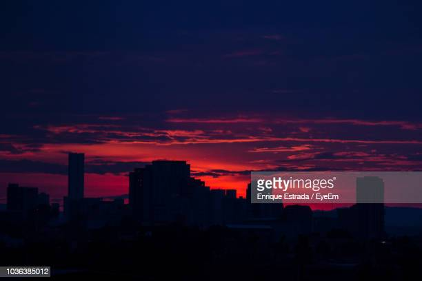 silhouette buildings against sky during sunset - guadalajara mexico stock pictures, royalty-free photos & images